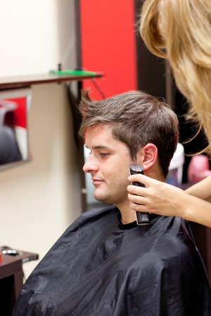 Young caucasian man being shaved photo