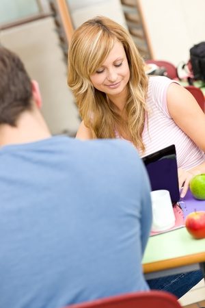 Seus couple of students working together in the cafeteria Stock Photo - 10245131