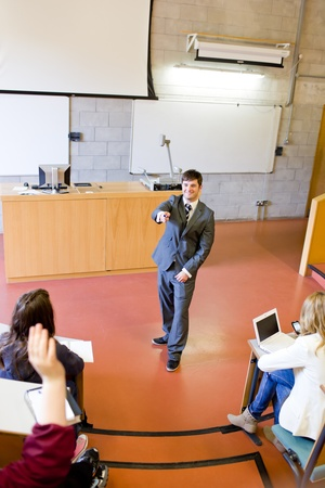 Charismatic teacher giving a lesson to university students photo