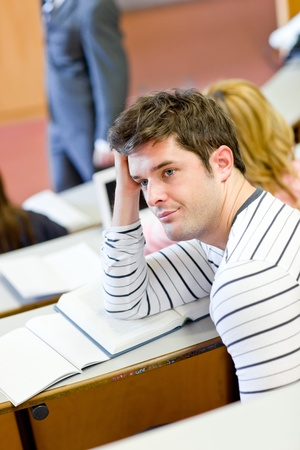 bore: Bored male student during an university lesson