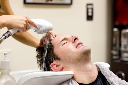 Cute man having his hair washed Stock Photo - 10245088
