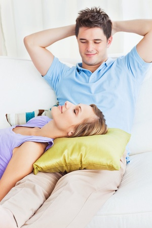 Adorable couple relaxing together on the sofa during the day Stock Photo - 10254090