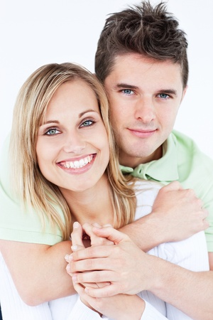 happy couple white background: Portrait of a lovely couple smiling at the camera standing against a white background Stock Photo