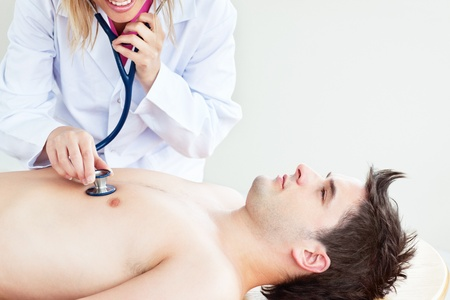 Close-up of a doctor feeling the breathing of a patient lying on a table photo
