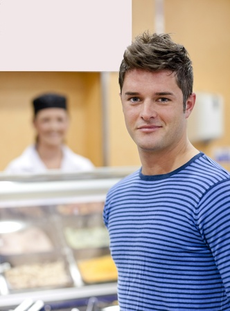 break fast: Portrait of a cheerful man choosing his lunch in the cafeteria Stock Photo