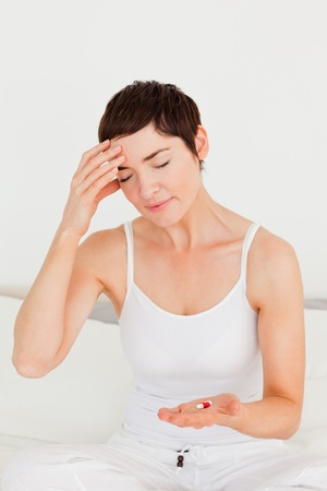 afflict: Woman having a headache in her bedroom Stock Photo