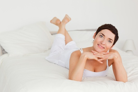 Lovely woman posing in her bedroom Stock Photo - 10791490