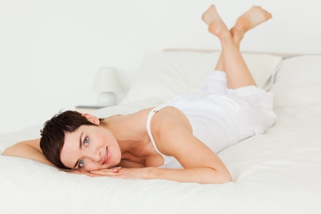 underclothes: Young woman posing on her bed Stock Photo