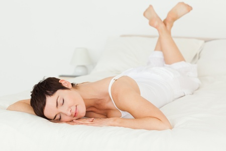 Calm woman posing on her bed photo