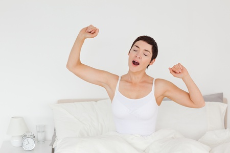 Close up of a woman stretching her arms to wake up photo