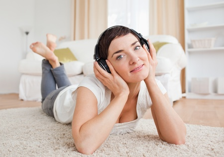 delighted: Close up of a delighted woman listening to music Stock Photo