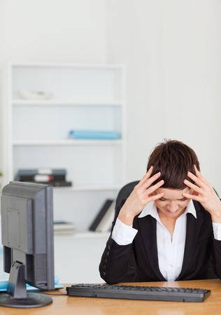 Unhappy secretary in her office Stock Photo - 10791606