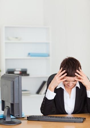 Unhappy secretary in her office Stock Photo - 10791606