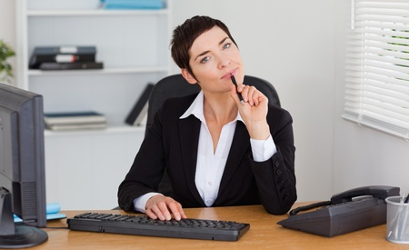 Thoughtful secretary in her office photo