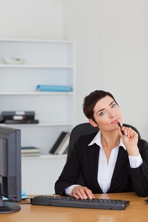 Portrait of a thoughtful secretary in her office photo