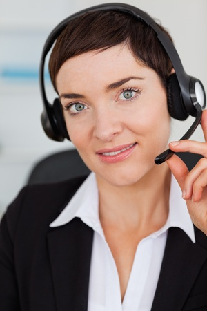 Portrait of a cute secretary calling with a headset in her office Stock Photo - 10784740
