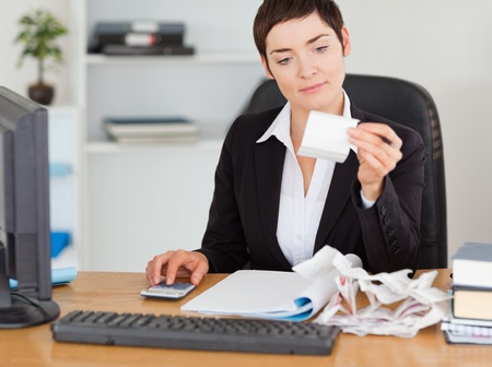 Professional office worker doing accountancy in her office photo