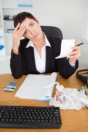 Portrait of a female accountant checking receipts in her office photo