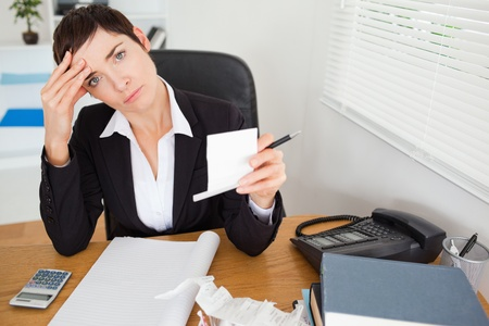Female accountant checking receipts  in her office photo