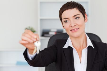 Secretary showing keys in her office photo