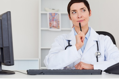 thoughful: Thoughful doctor in her office Stock Photo
