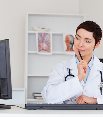 Portrait of a thoughful female doctor in her office Stock Photo - 10791152