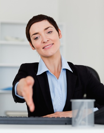 Portrait of a charming business woman giving her hand Stock Photo - 10917239