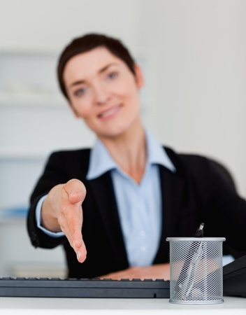 Portrait of a young business woman giving her hand with the camera focus on her hand Stock Photo - 10917236