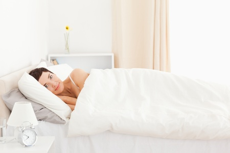 Charming woman waking up in her bedroom Stock Photo - 11180824