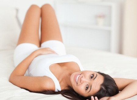 close up of a smiling woman lying on bed in bedroom Stock Photo - 11198008