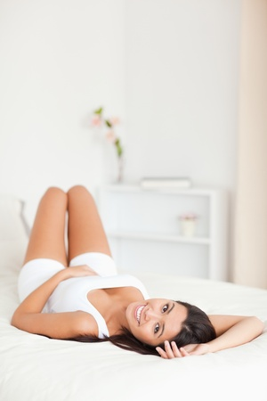 charming woman lying on bed in bedroom Stock Photo - 11198683
