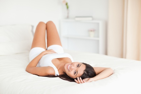cute woman lying on bed in bedroom Stock Photo - 11198698