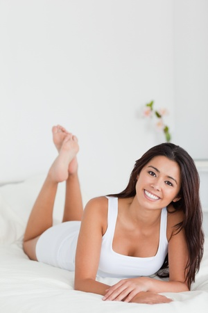 charming woman lying on bed in bedroom with crossed legs Stock Photo - 11202347
