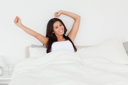 waking beautiful woman in bed in bedroom photo