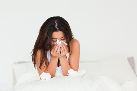 afflict: sad woman sitting in bed in bedroom