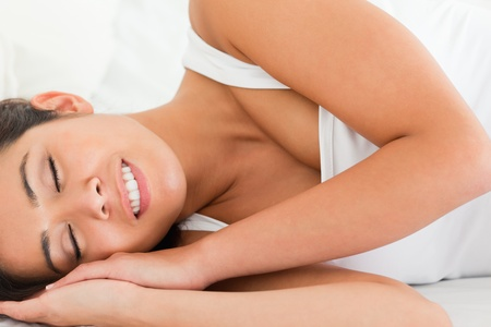 relaxing smiling woman in bedroom photo