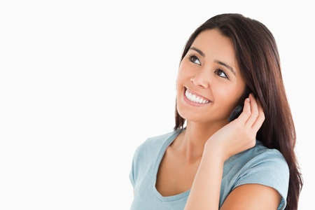 Gorgeous woman on the phone standing against a white background Stock Photo - 11198811