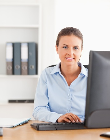 Working woman using a computer in her office photo