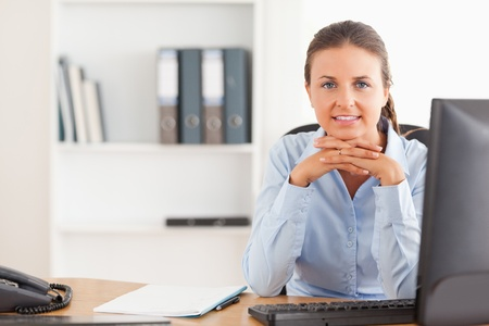 Working woman posing in her office photo