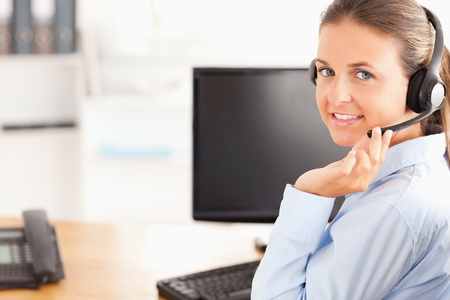 Working woman with a headset looking at the camera Stock Photo - 11204612