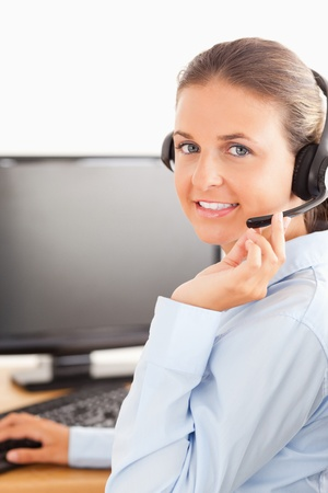 Close up of an office worker with a headset looking at the camera photo