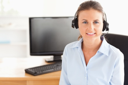 Secretary with a headset posing in her office Stock Photo - 11202059