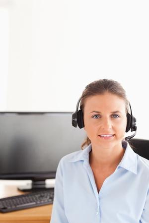 Secretary wearing a headset posing photo