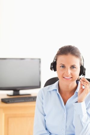 Smiling secretary wearing a headset in her office Stock Photo - 11199271