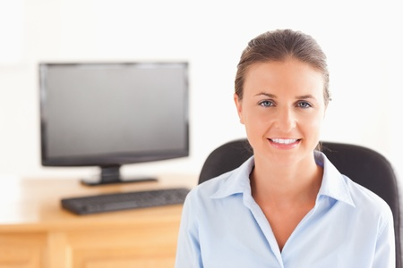 Businesswoman posing in her office looking at the camera photo