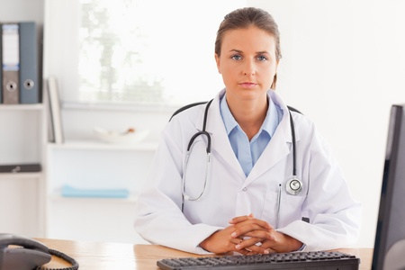 Doctor posing in her office Stock Photo - 11203812