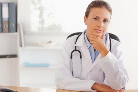 doctor office: Cute female doctor posing in her office
