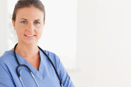 Close up of a nurse standing in a hospital photo