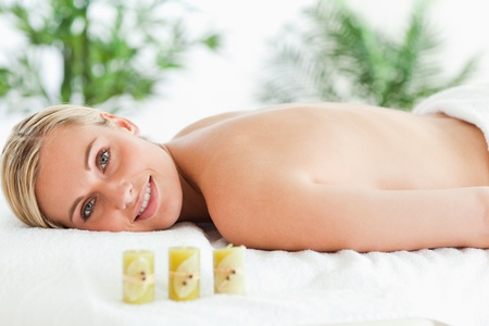 Blonde woman lying on massage lounger in a wellness center photo