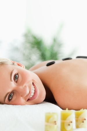 Close up of a blonde woman having a stone therapy in a wellness center Stock Photo - 11225859